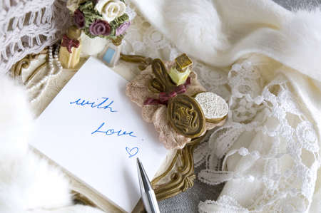 note pad with text with love in romance style photo