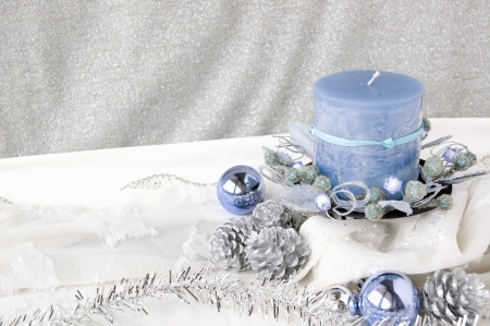 blue candle on christmas decoration background