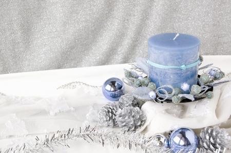 blue candle on christmas decoration background