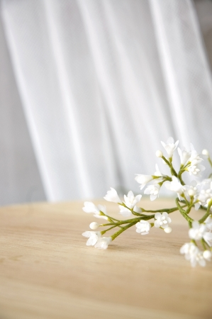 pretty white artificial flowers on table