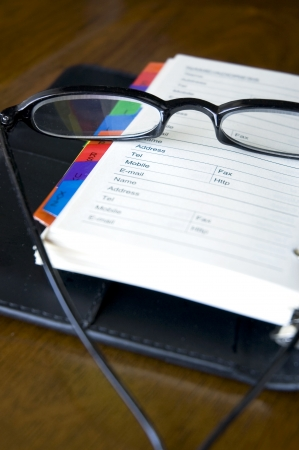 eyeglasses put on page of personal organizer