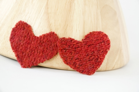 two red heart with wooden background photo
