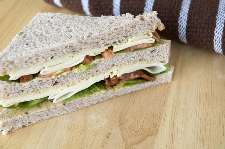 chicken and bacon sandwich on wooden table photo