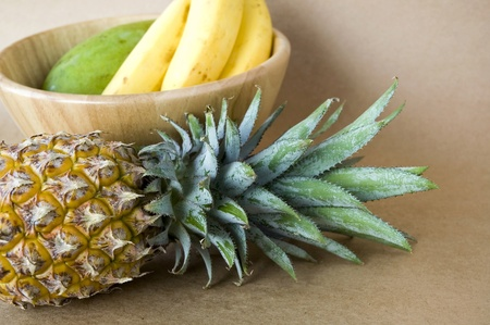 tropical fruits pineapple with banana and mango bowl photo