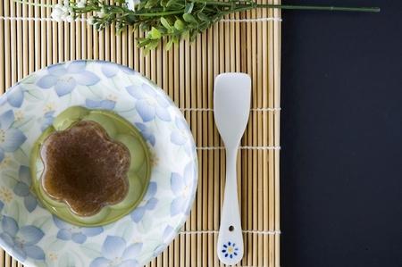 custard flavor: matcha green tea pudding serve on floral plate Stock Photo