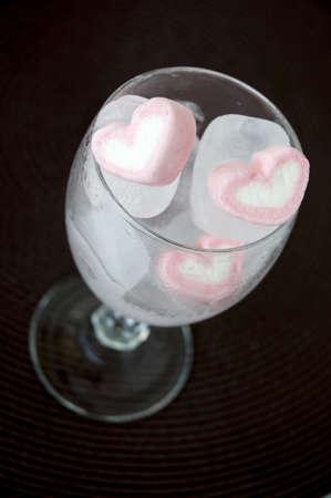 pink heart marshmallow frozen in ice cube Stock Photo - 19266896