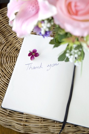 thank you note: thank you note on white page with pink blossom Stock Photo