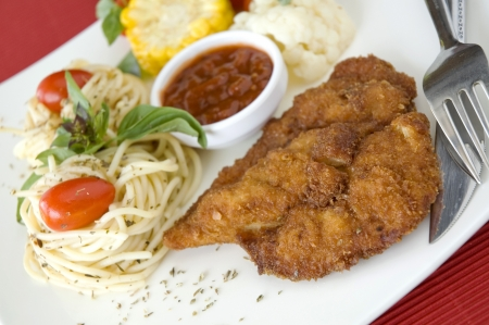 close up fried chicken with pasta photo