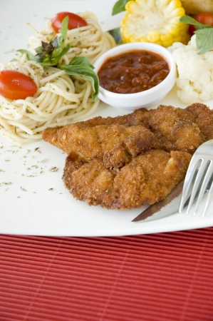 fried chicken dish with red space below for text