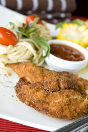 fried chicken with side dish serve on white plate photo