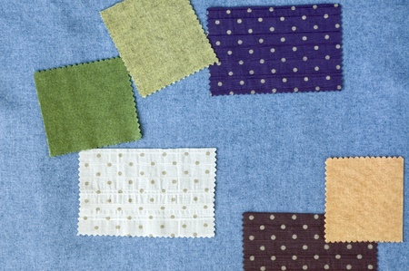 pieces of colorful fabric on blue fabric