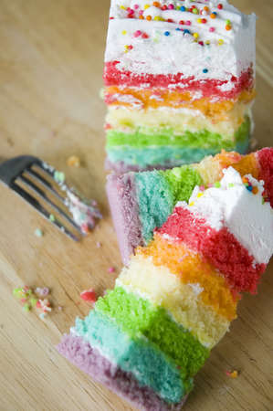 pieces of colorful layer cake in party photo