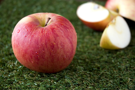 close up fresh apple and apple slices on background Stock Photo - 23017567