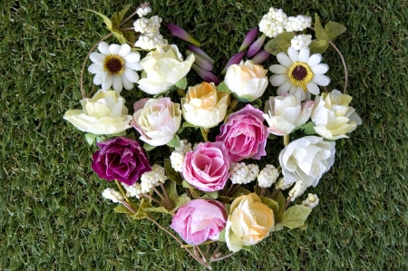 many kinds of fabric flowers put in heart shape photo