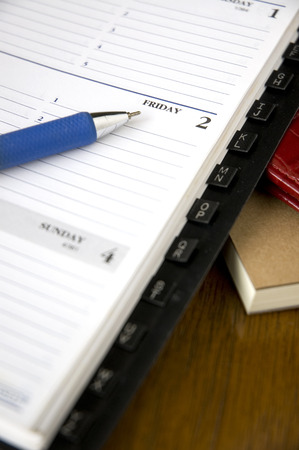 blue pen point to friday on planner Stock Photo - 23907635