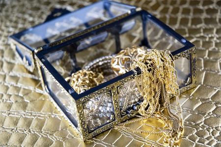 gloden: gloden jewelry in treasure chest Stock Photo