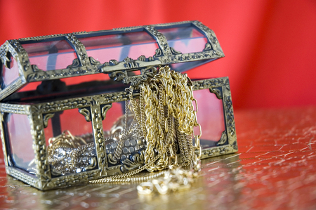 jewelry in treasure chest with red  photo