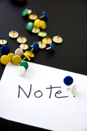 note on paper with colorful pins photo