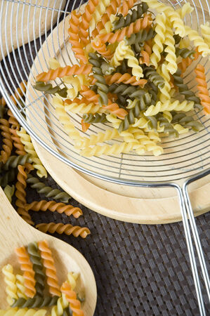 bolter: close up colorful pasta in bolter Stock Photo