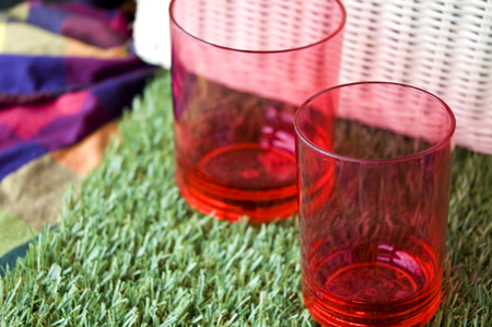 close up two sizes of red plastic cups photo