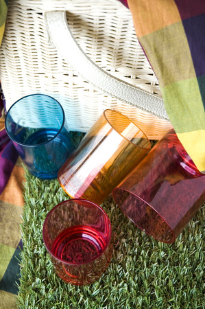 colorful plastic cups with white basket background photo