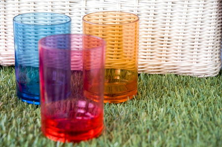 colorful glasses with white basket background photo