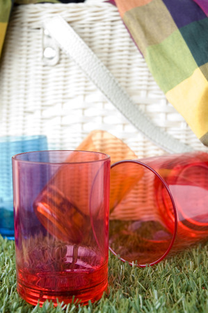 red plastic cups on grass with basket background photo