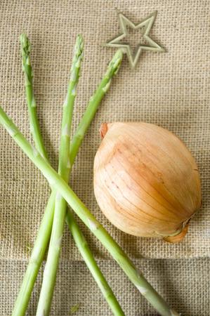 asparagus and onion on sackcloth