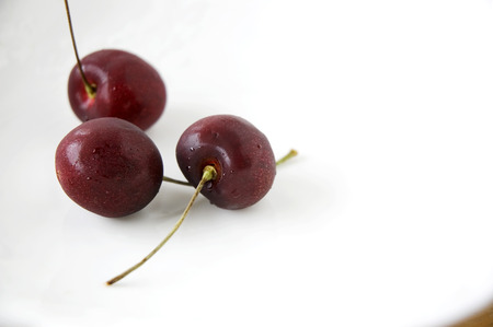 cherries on white plate background