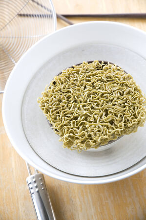 green instant noodles in white bowl