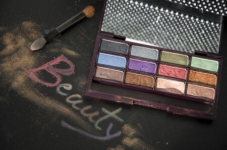 words beauty write on black with colorful eyeshadow photo