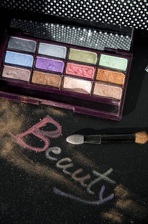 words beauty write with eyeshadow on black background photo
