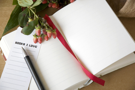 pen point to bookmark put on blank page notebook