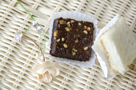 mini brownie and sandwiches on basket photo