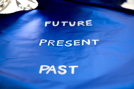 focus on present concept on blue background photo