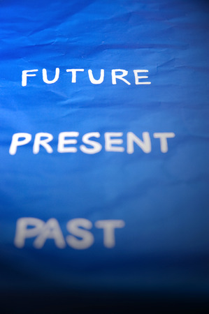 living moment: focus to future wording on blue background