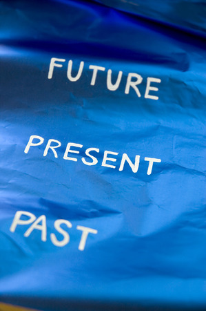 timing future present past on blue background photo