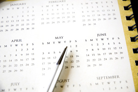 pen point to public holiday first of may Stock Photo - 32654483