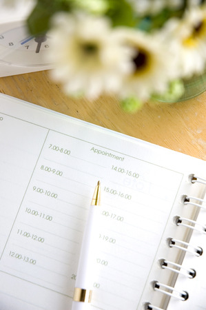 planner book with pen on table