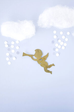float cotton cloud: cupid in the sky with cloud and snow background Stock Photo