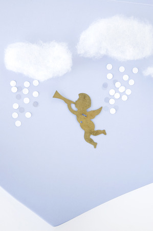 float cotton cloud: cupid on the sky with snow background