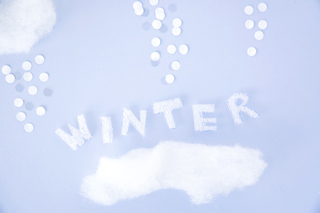 float cotton cloud: winter text on sky background