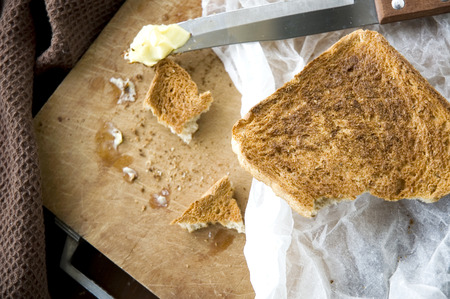 messy kitchen: bread toast with butter in messy kitchen Stock Photo