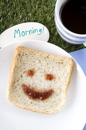 smile face on bread with coffee and morning note Stock Photo