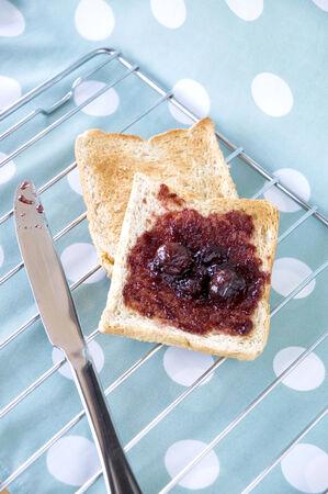wheat bread toast with black cherry jam on polka dots background Stock Photo