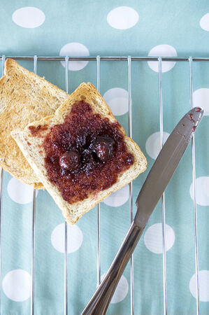 toast with black cherry jam for breakfast photo