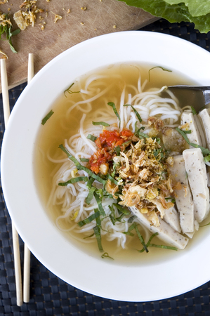 pho noodle vietnam food with chopstick on background photo
