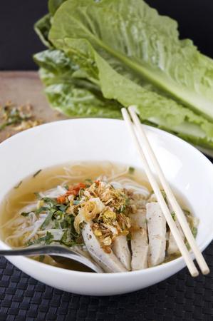 pho vietnamese food with fresh lettuce background photo