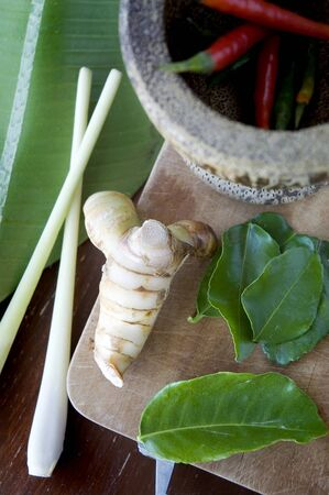 tomyum ingredients put on cutting board with mortar photo