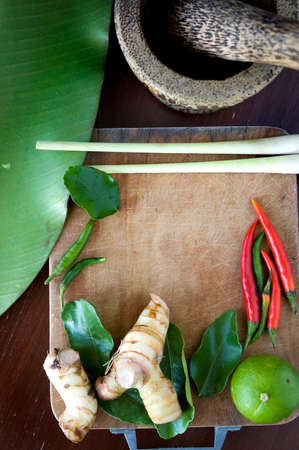 tomyum ingredients put on wooden cutting board with mortar photo